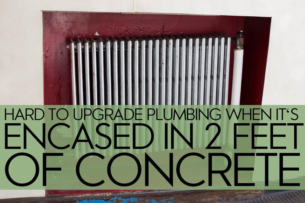 Strong Community Schools plumbing behind Concrete.jpg