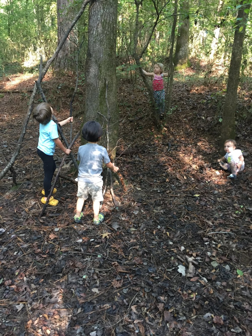 Children at AFK Playgroup have the space and the community to work on their own ideas that require planning, teamwork, and problem-solving, like this fort.