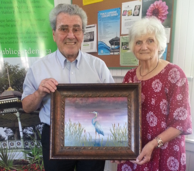 An internationally recognized medical doctor, professor, researcher and author, Dr T. J (Jock) Murray, finds relaxation with his oil paints. He recently presented Judith Cabrita, Chair of the Board, The Friends of The Public Gardens, with a painting he had done of the blue heron.