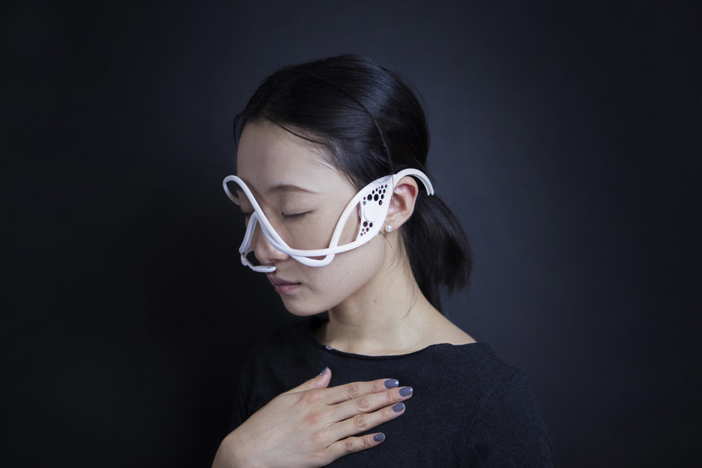 Masque is a compact system that manipulates the user's perception of his/her own respiration by providing false auditory feedback. The wearable mask has respiration sensor, bone conduction speaker embedded.