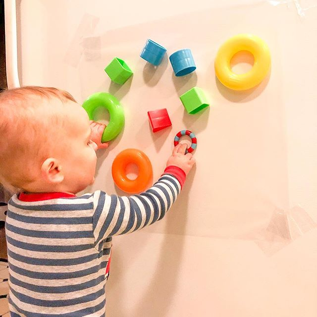 I think I first saw this idea from @happytoddlerplaytime Best thing about it—it took less than 5 minutes to set up. All I did was tape clear contact paper (from @dollartree ) on the refrigerator and then I added some of Bubba's favorite toys. This was very engaging for him. What that means for a 1 year old is not necessarily that he played in this one spot for a long time. More 1-2 minutes at a time for us😂. BUT he kept going back to this set up to explore a little more! This is great for babies that a sitting also! Just adjust the height!
