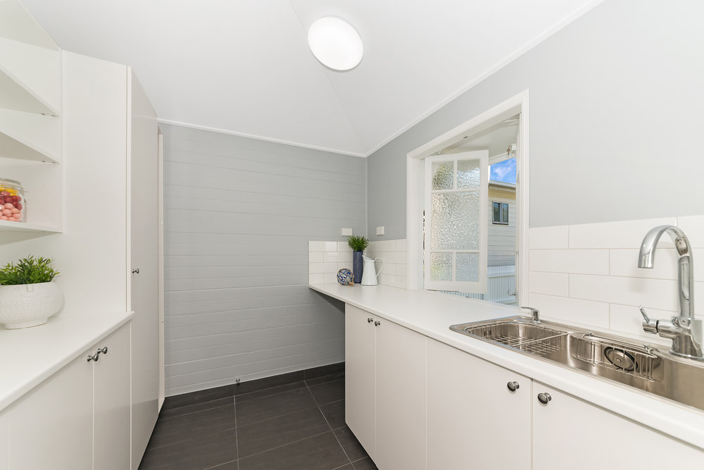 Spacious laundry and butlers pantry created allowed for ample storage.