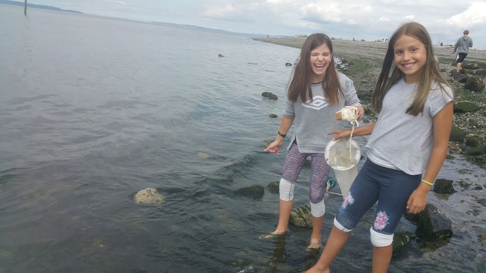 5th graders, Annabelle and Aubrey, fishing to compare plankton from freshwater and saltwater in Edmonds, WA
