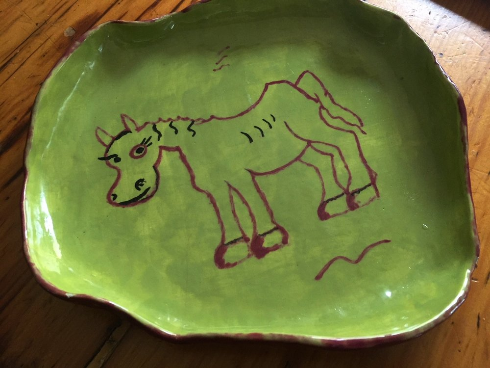 The Dany Plate started my collection of hand painted plates. .