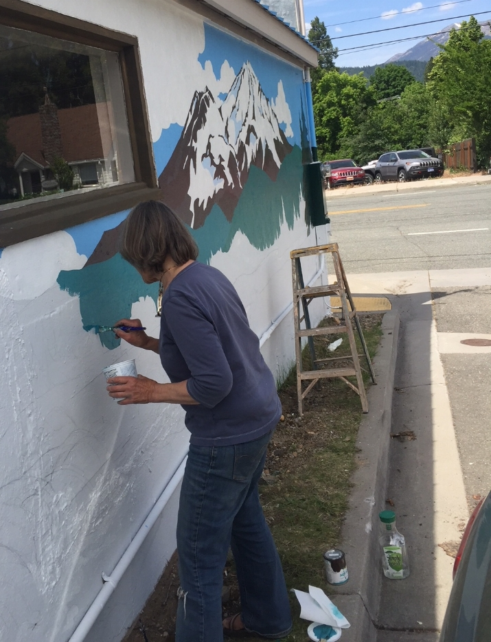 Kim Solga working on the Mount Shasta Mural with funding from the Shasta regional community foundation's arts in the community grant