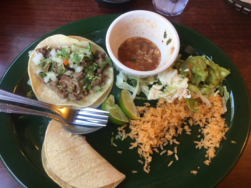 Taco Combo - I choose one shrimp, one steak taco Mexican rice, rancho beans with sour cream and rich creamy guacamole.
