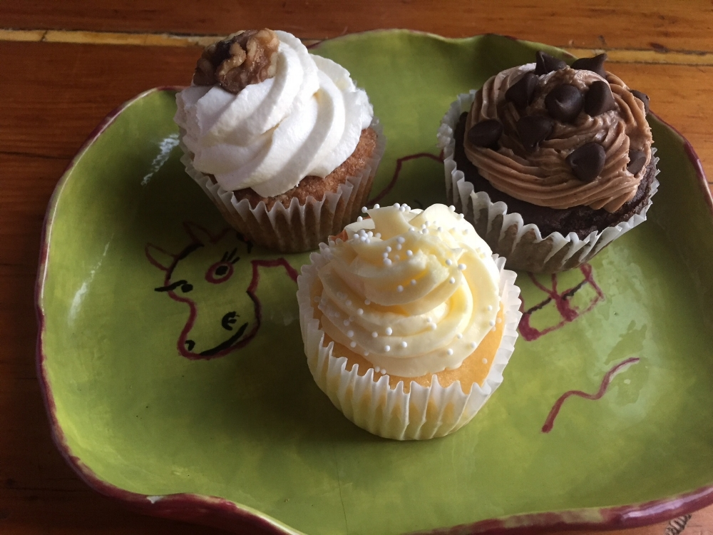 Cupcakes...Carrot with frosting and a walnut, Lemon with buttercream frosting and Chocolate with chocolate buttercream frosting.