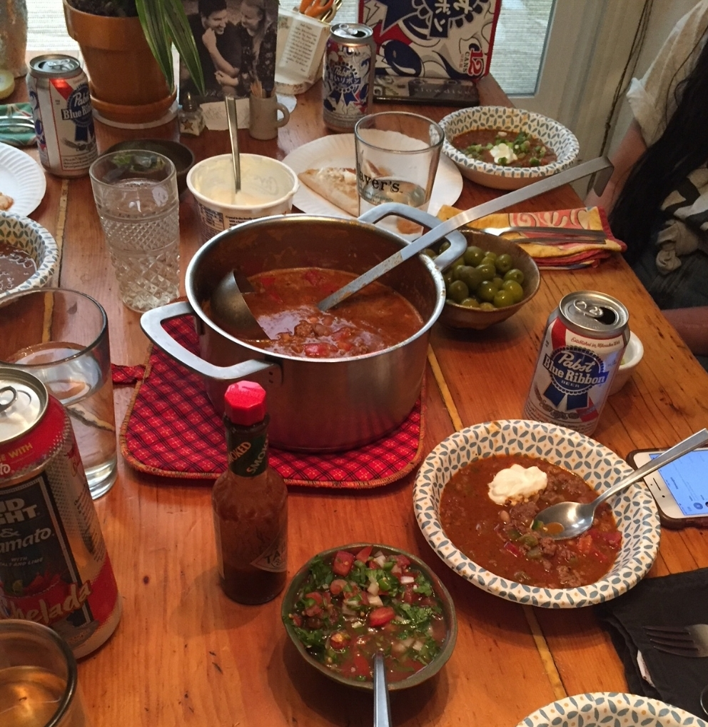 Crock Pot Open a Can Chili family dinner with paper plates. A nice reward after a hard days work!