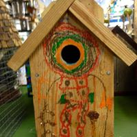 Embellished entry to a birdhouse
