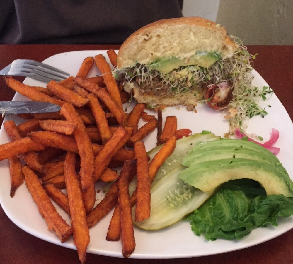 California Garden Burger with lots of topping and sweet potato fries.