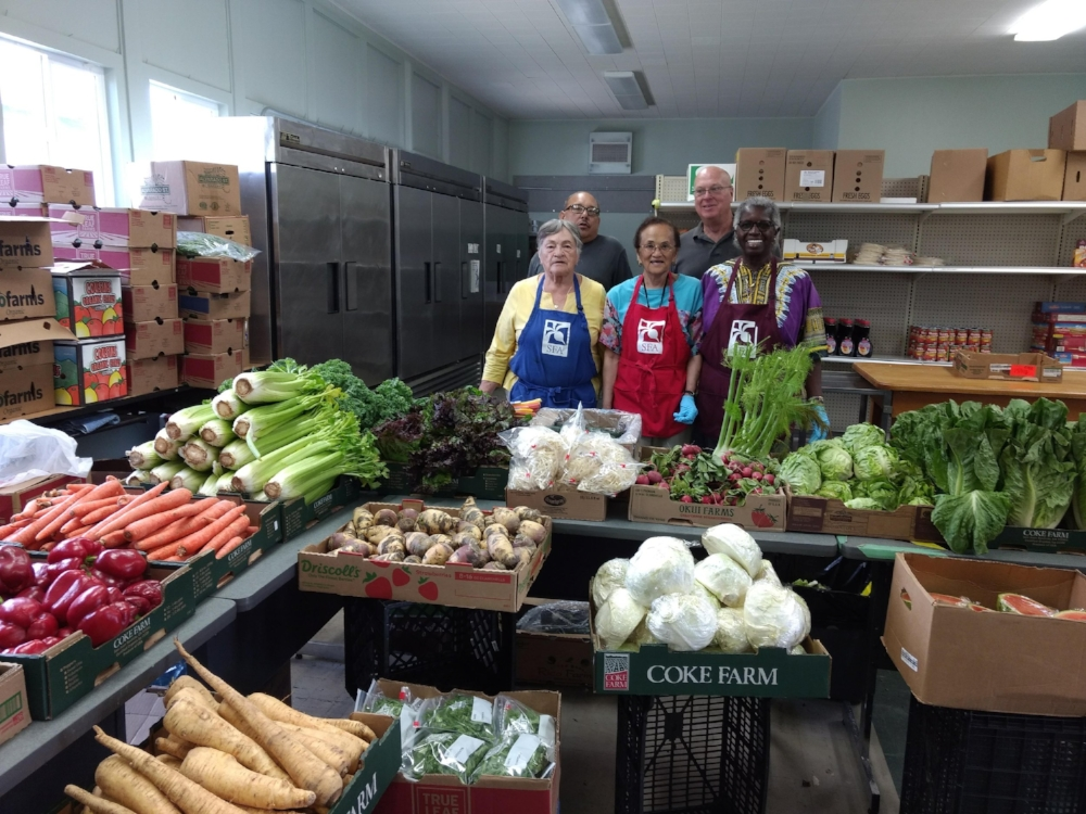 Volunteers set out the weeks donation of produce from General Produce.