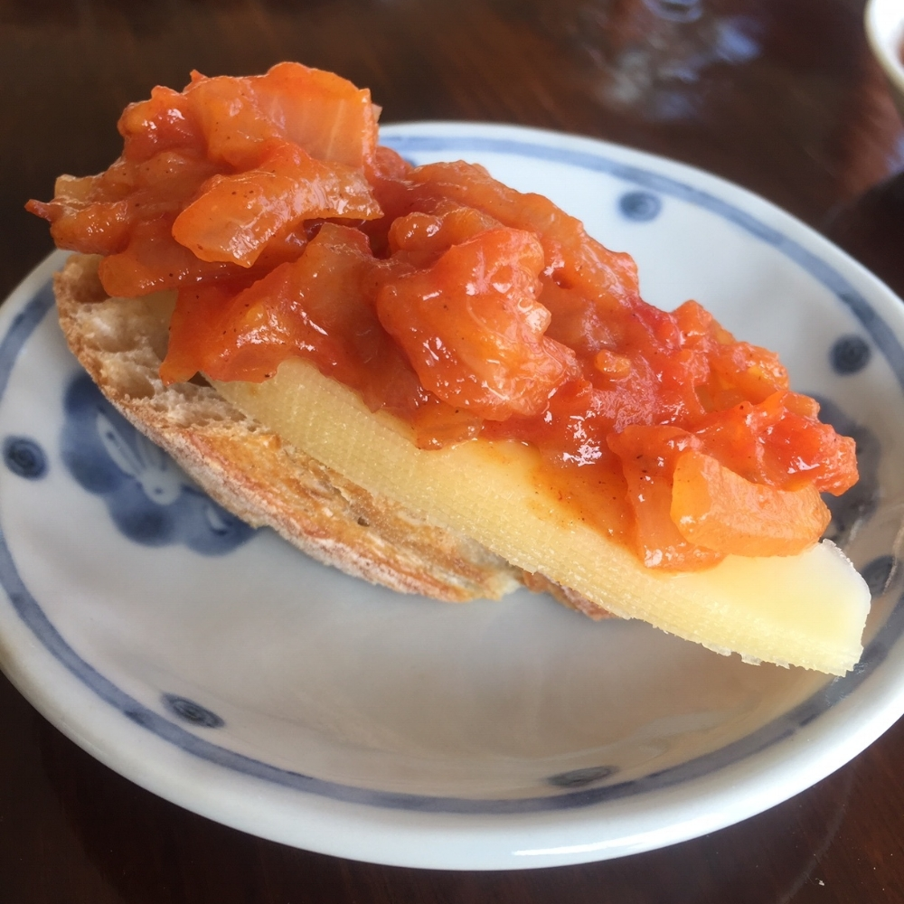 Tomato Onion Jam adds a sweet and savory to cheese and crusty bread.