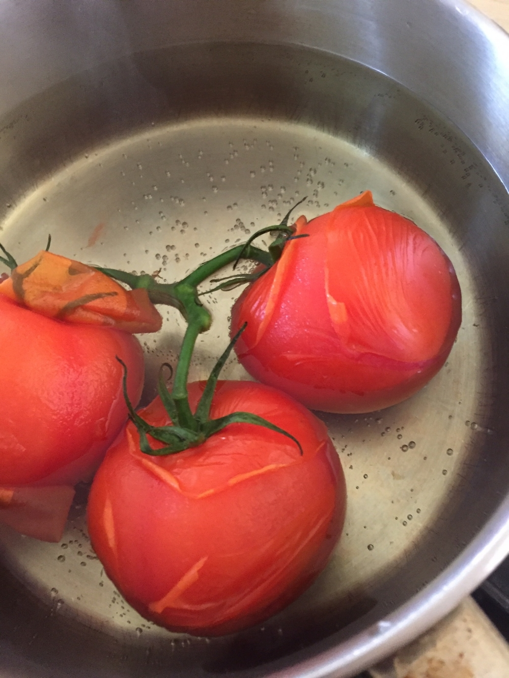 To peel tomatoes easily- drop into boiling water for 5 seconds then plunge into ice water. The skin slides right off.