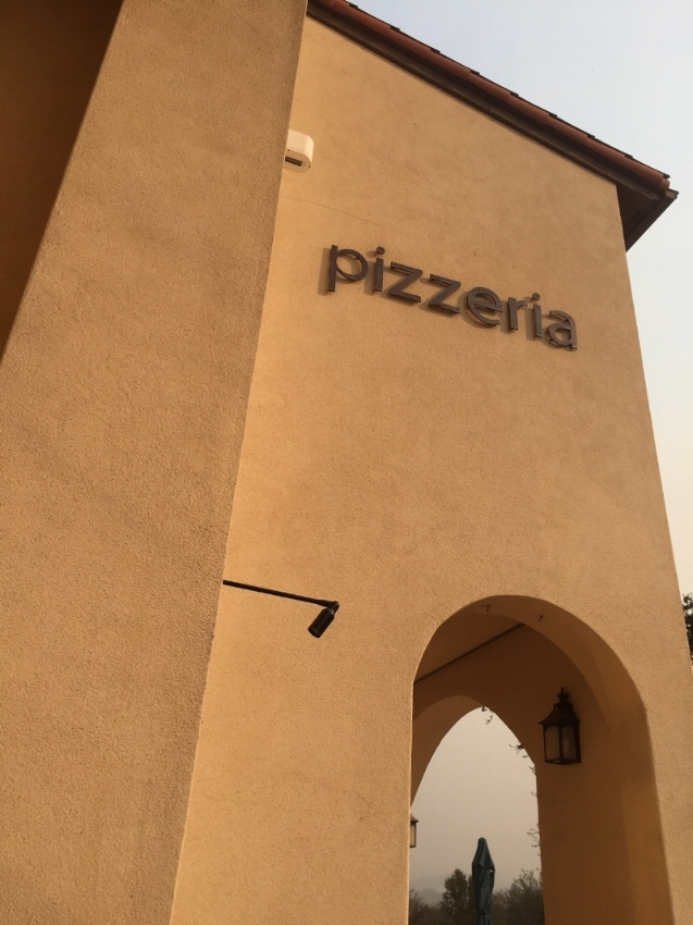 Pizzeria serving farm to table topping and fresh salads.
