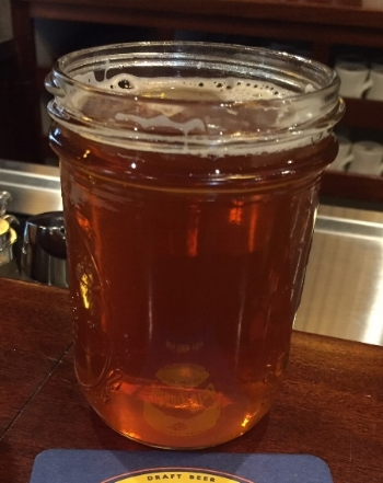 Water and imperial Golden ale are served in jelly jars.
