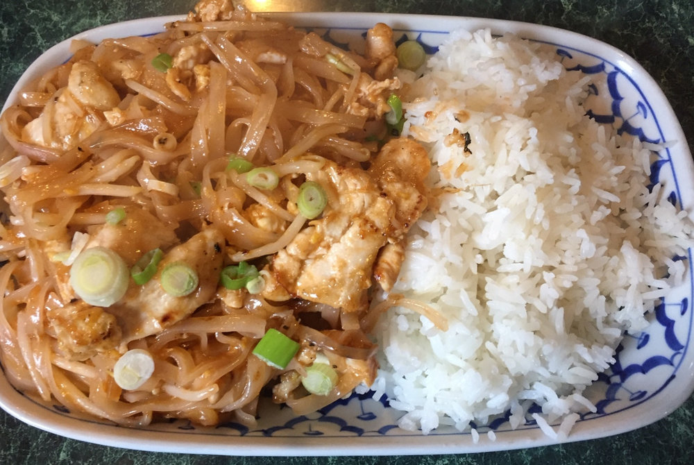 Pad Thai served with chicken served with rice on the lunch menu