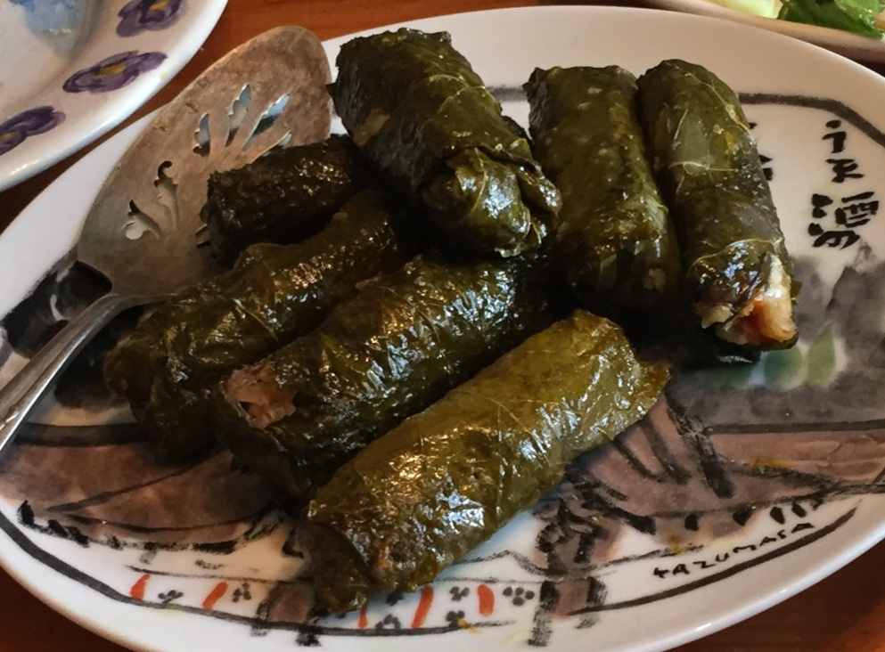 Stuffed Grape Leaves  and  the big greek salad  make a meal that serves a crowd. Vegan and GF