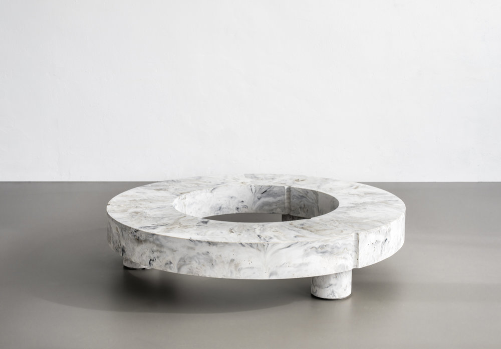 gestalt LOW TABLE - Gestalt low table is a barrel full of well matched contradictions. Both brutal but elegant, heavy but light and functional but sculptural. SMENT made sure no feature on Gestalt is lavish by ruling out every idle detail, leaving Gestalt being the embodiment of its most important characteristic: concrete.SMENT took on the challenge to create a concrete low table reduced to it's fundaments through thorough exploration of the matter. The choice of pigmentation and negative space give the concrete table a surprising lightness and makes every piece unique. The organic round shapes make Gestalt a classic example of a coffee table and makes the colour play coming to its own perfectly.Gestalt is positioned low to the ground, making it a prominent object you can't ignore. Because of the shape and well finished, terrazzo bottom of the deconstructable table, the tabletop can be put on its side to serve as a mere object in the room. Gestalt low table is the result of mass meeting grace. For inquiries, please contact the studio.