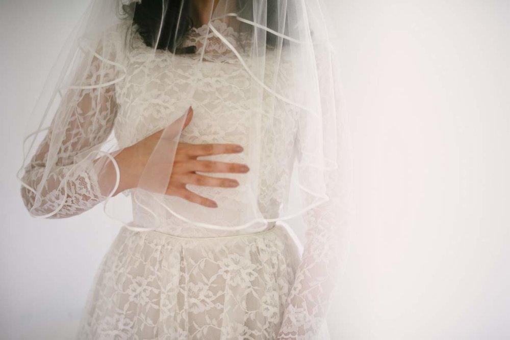 Lais wearing 1950s lace wedding dress