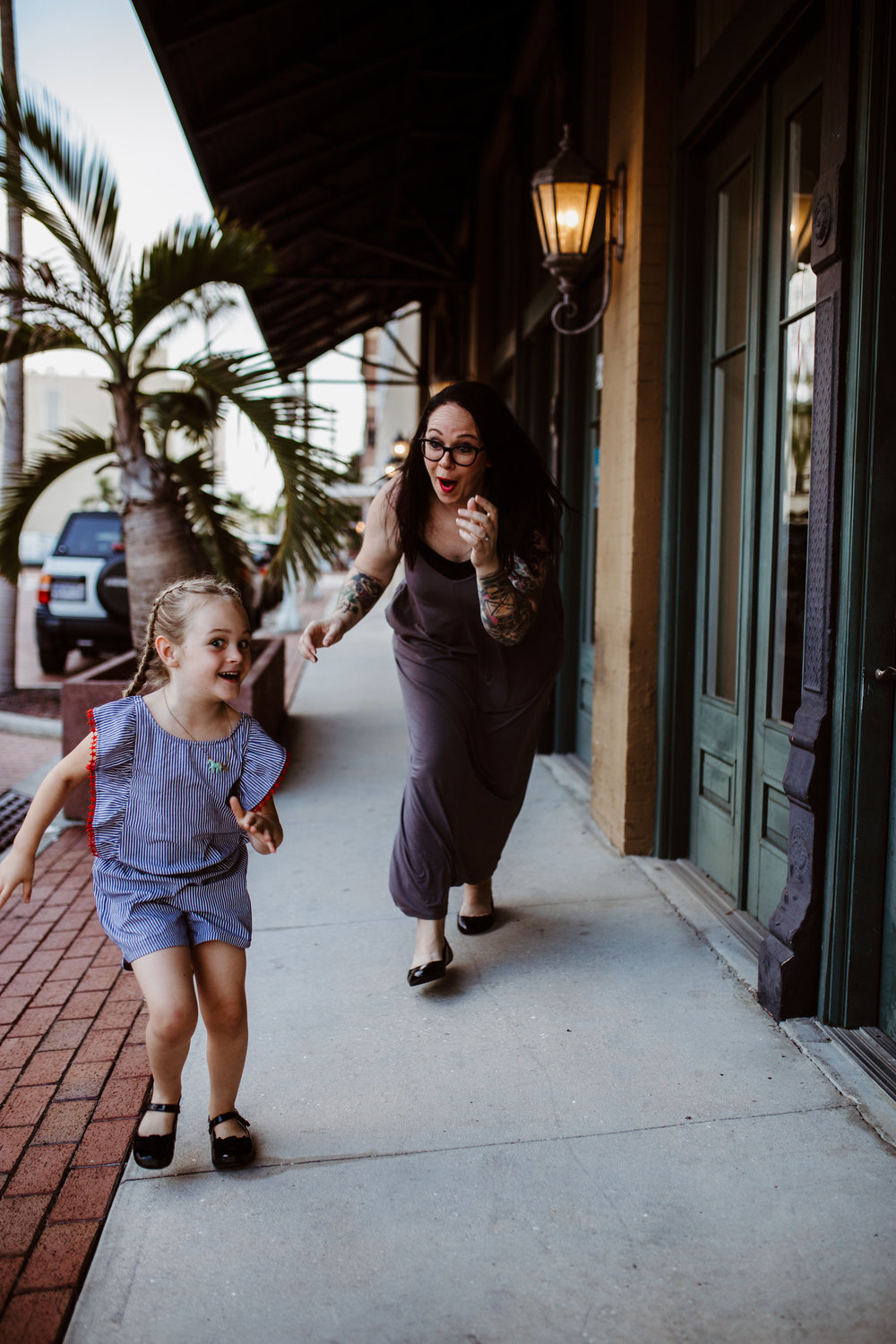 Little girl and her mom have a race in the streets of downtown fort myers
