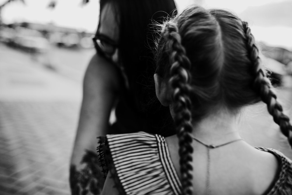 Little girl with pig tail braids and her mom