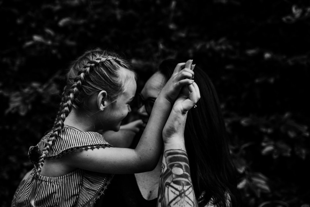 Little girl and mother laughing together
