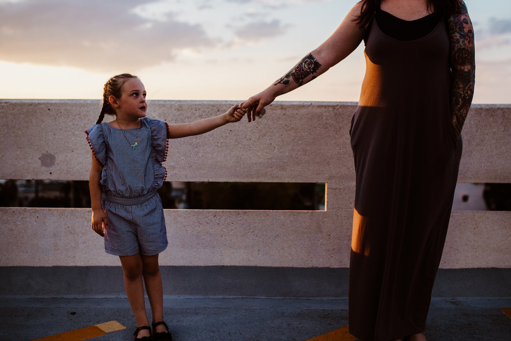 Mom holds hands with daughter on Fort Myers roof