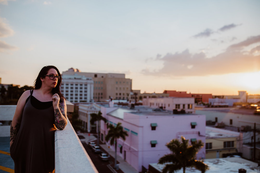 Woman on a roof in downtown fort myers at sunset