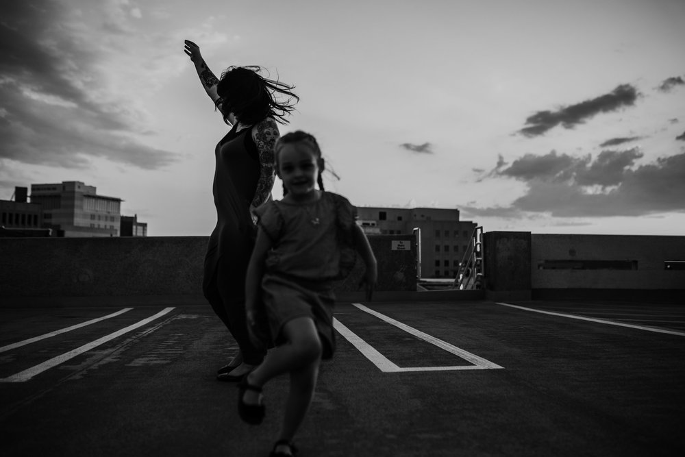 Mother and daughter dance at sunset in downtown fort myers