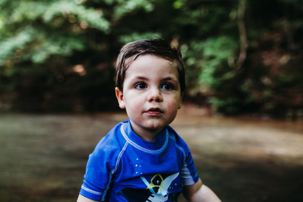 Little boy standing in creek at Montgomery Bell State Park