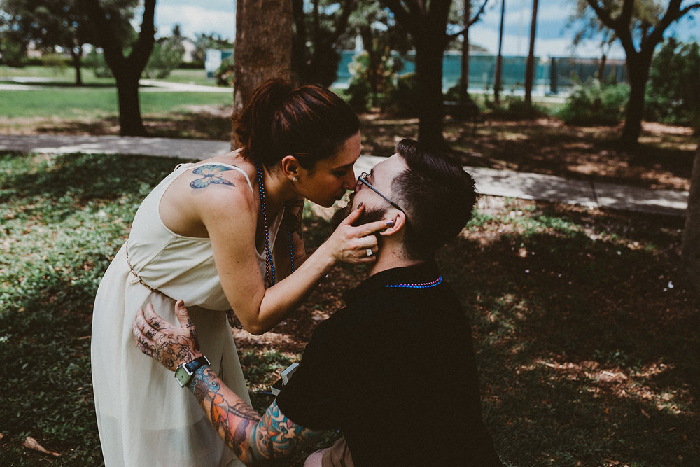 Couple kiss after proposal at Three Oaks Park