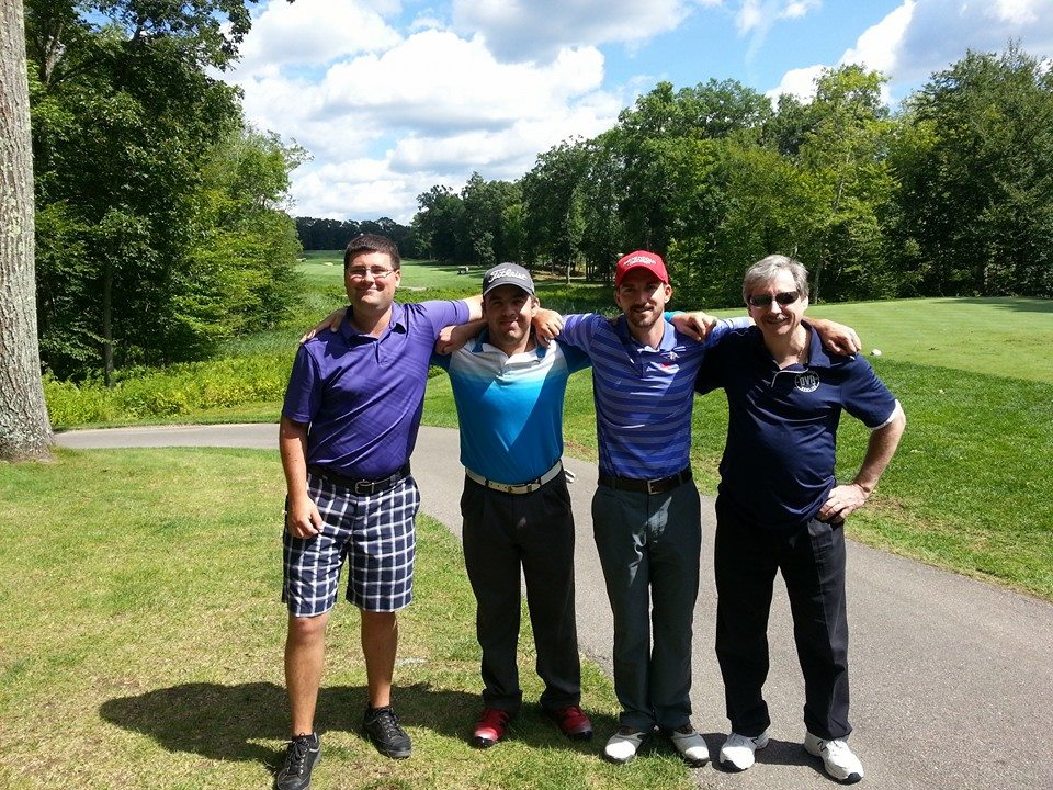 Kevin (left) with his golfing buddies.