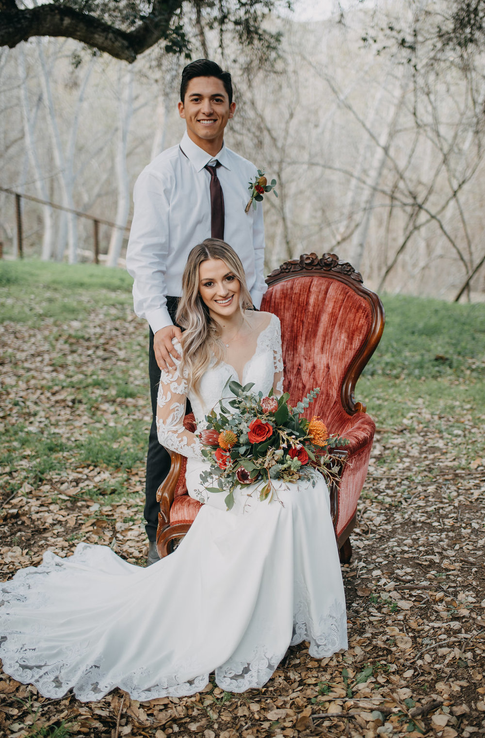 boho wedding photo idea outdoors natural wedding photos red velvet chair seasonal flowers