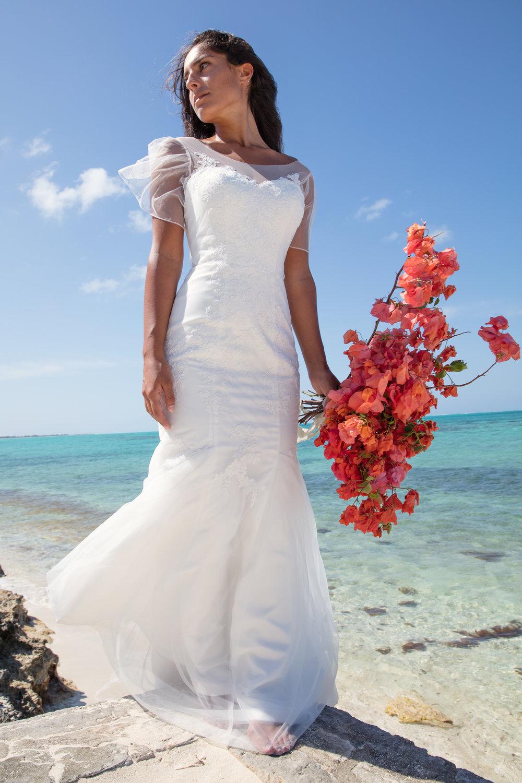 island wedding destination wedding seasonal floral bouquet mermaid fit clean wedding dress for modern brides