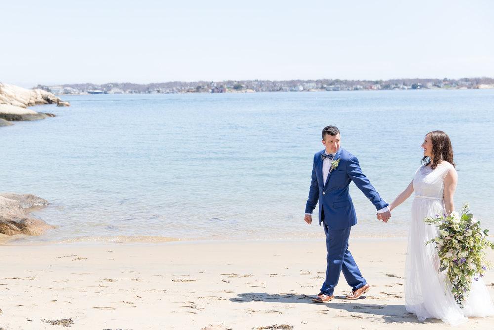 walking by the beach wedding cascade wedding bouquet light summer wedding gown