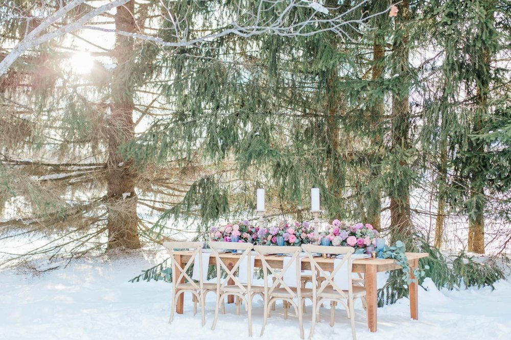 snowy outdoor wedding table setting flower centerpiece wedding in forest
