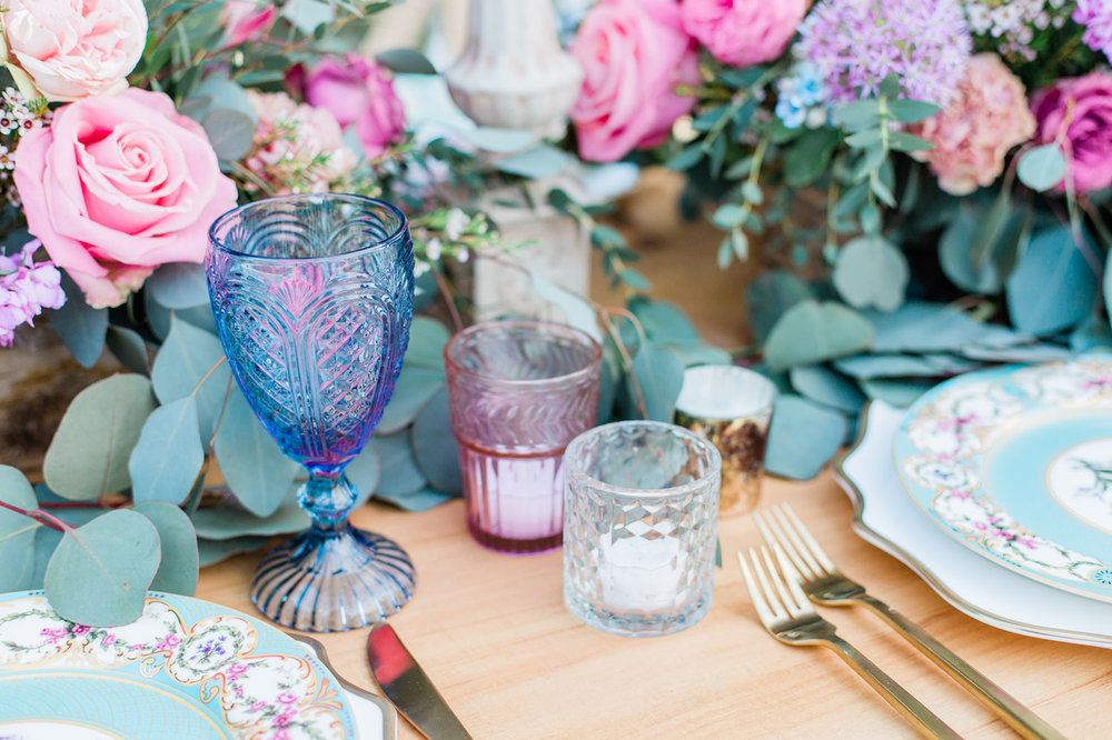 winter jewel tone wedding decorations, colored glass flower centerpiece and china plates
