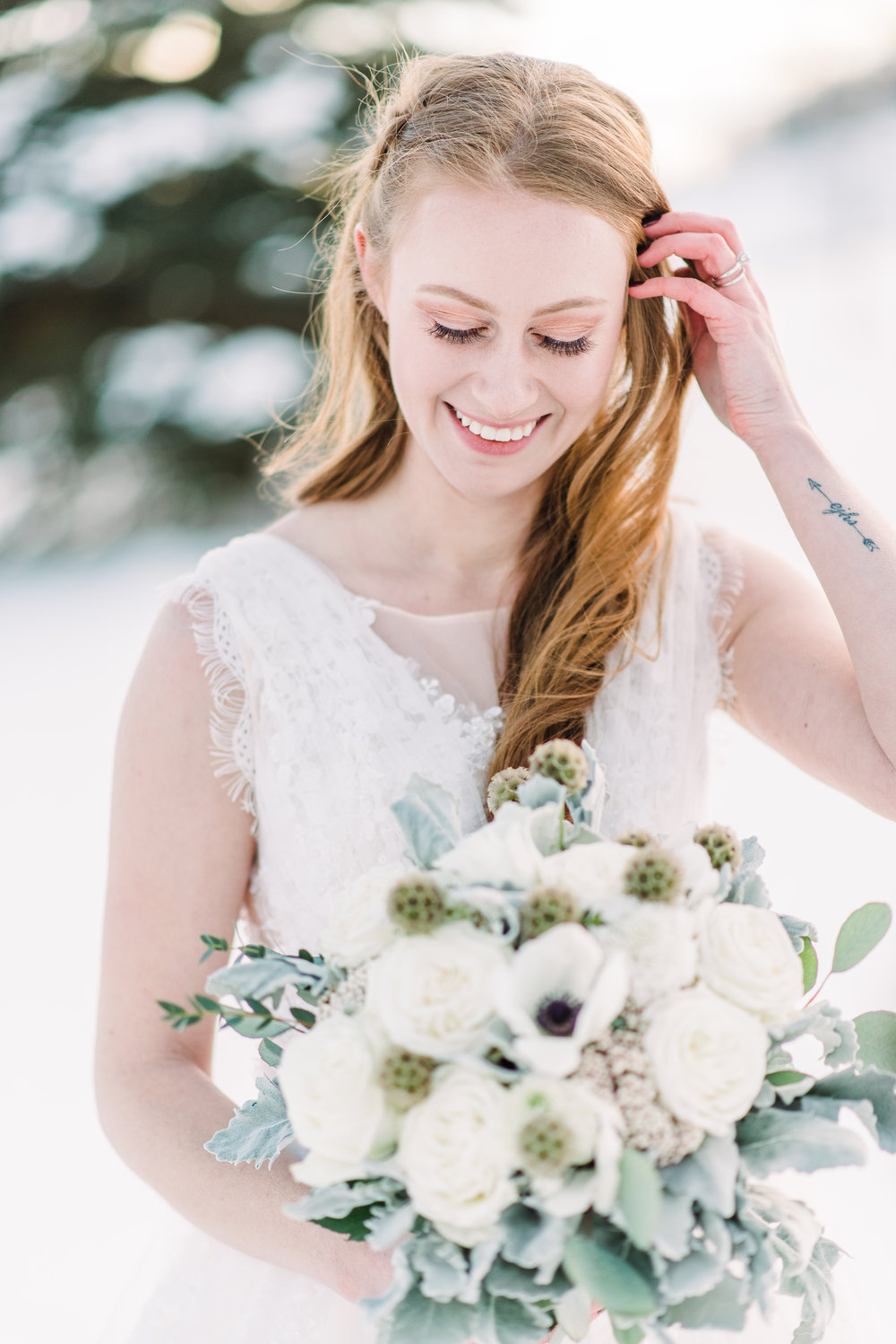 natural hair and makeup for brides brides with tattoo winter outdoor wedding photoshoot