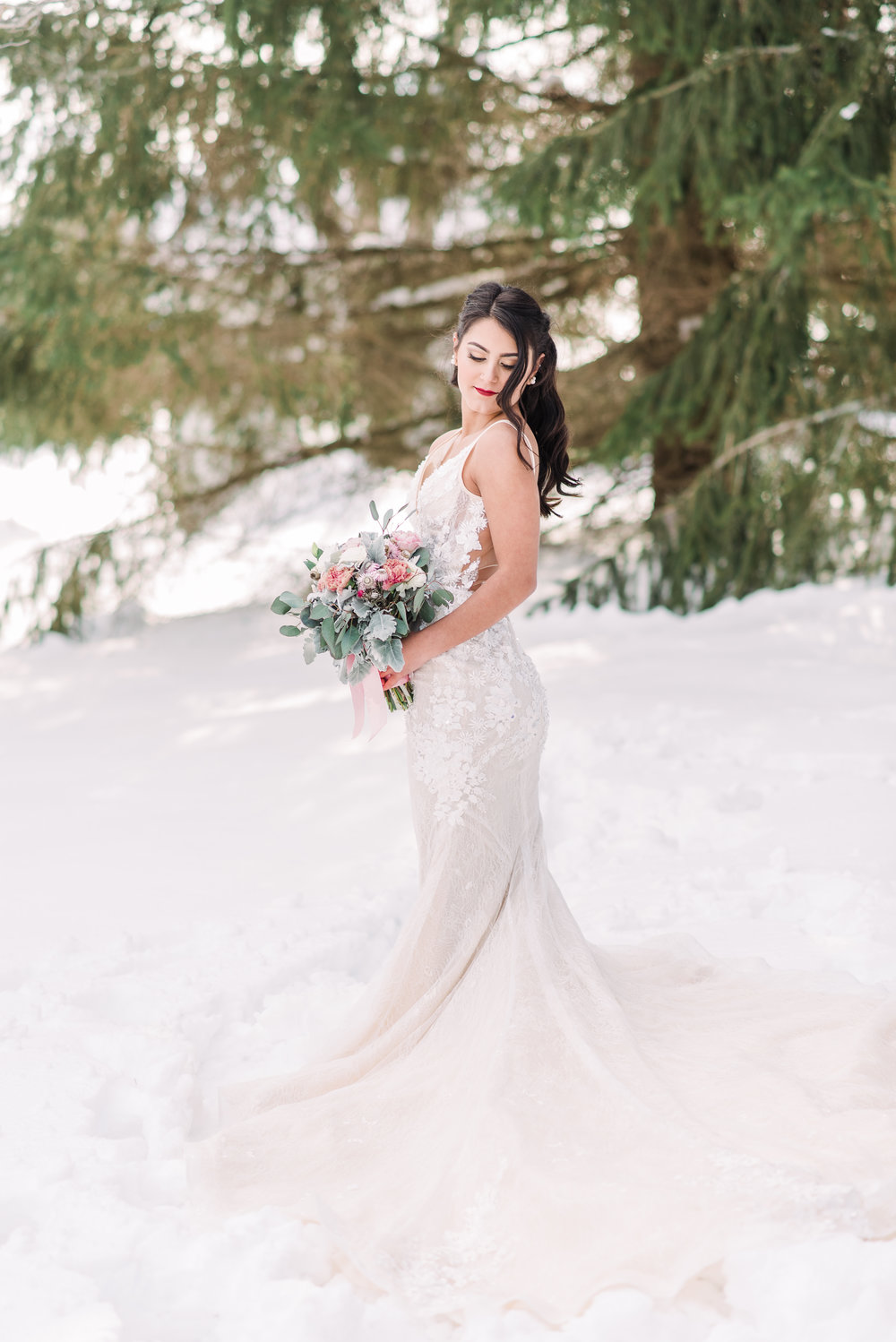 beautiful court train wedding dress in the snow