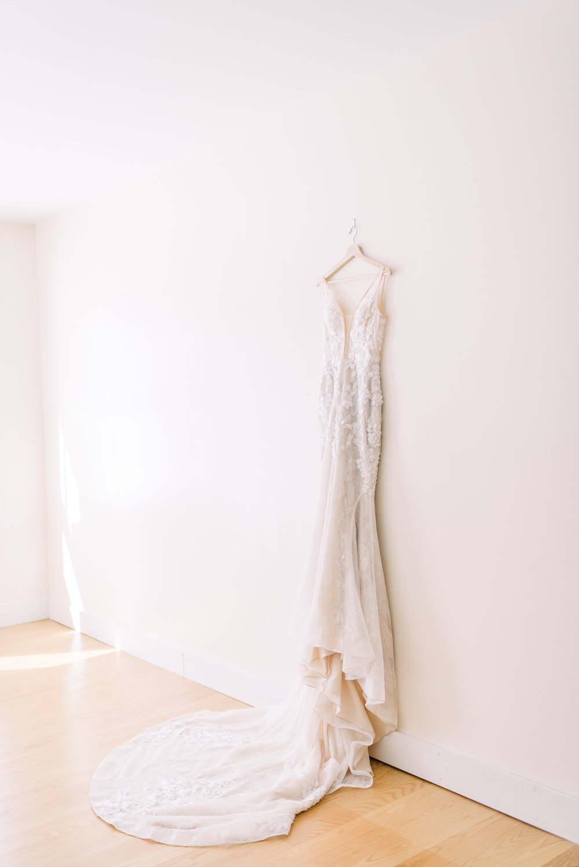 hanging wedding dress photo peach toned unique wedding dress under $1000