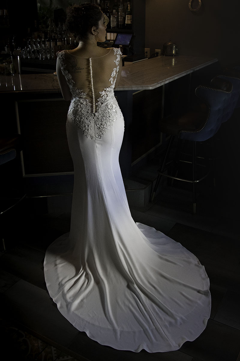 mermaid fit wedding dress with court train pearl button back