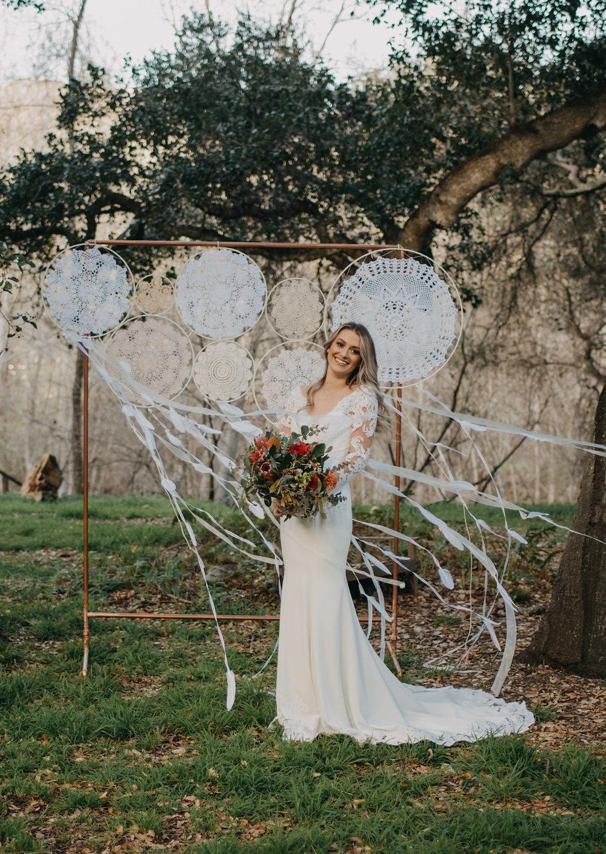 bohemian fantasy wedding photoshoot laced long sleeve wedding gown under $1000