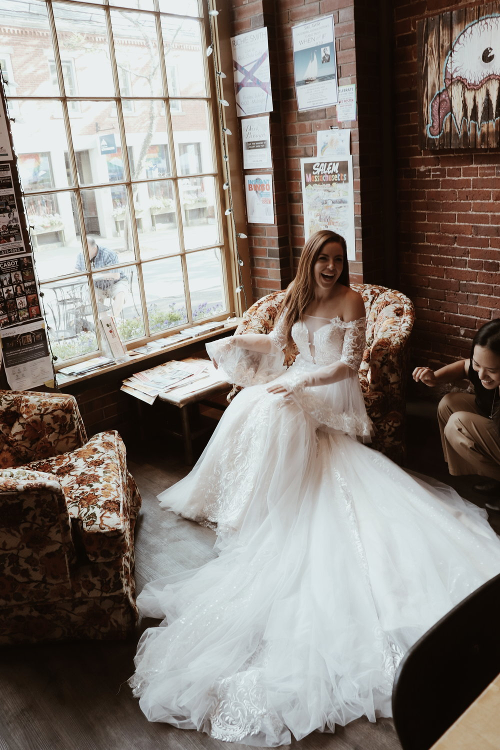 bride laughing in wedding gown