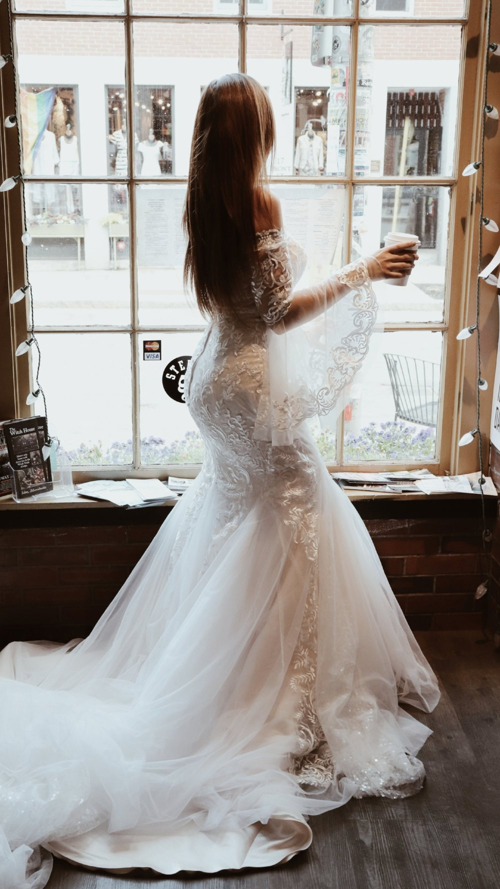 bride facing window gorgeous train
