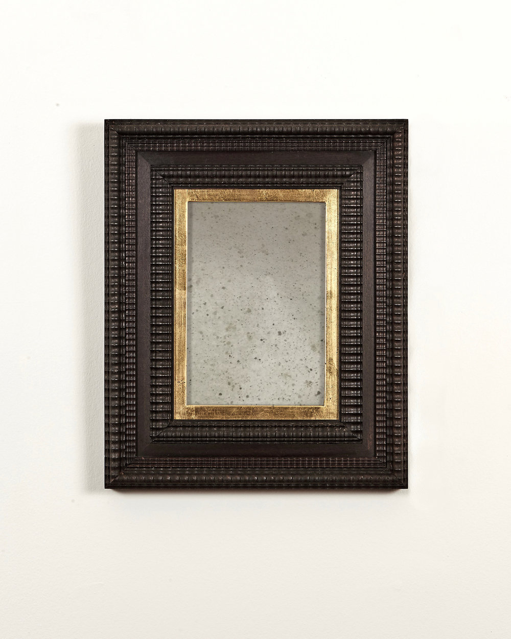 Antiqued mirror in Dutch ripple frame