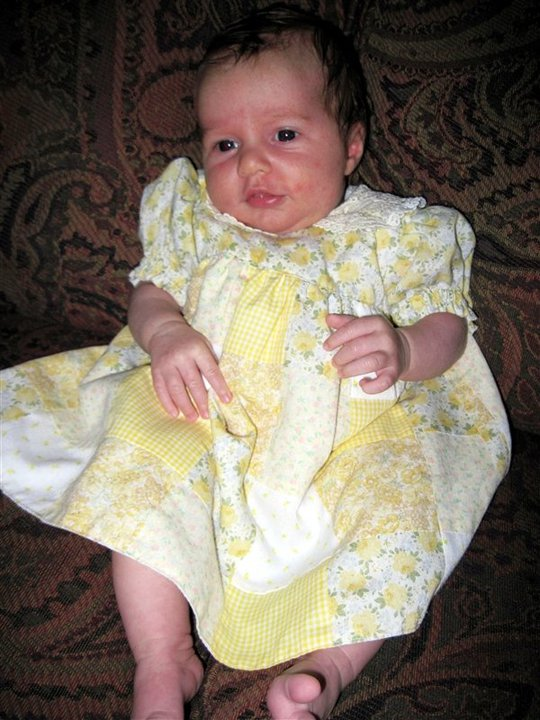 This is my newest grandniece, Brinnley, wearing the dress I made her aunt (my niece) about 30 years ago, during the days I was making patchwork clothing. She is the 6th baby to wear it over the years! All three of her older sisters have worn it. And it seems to be holding up very nicely.