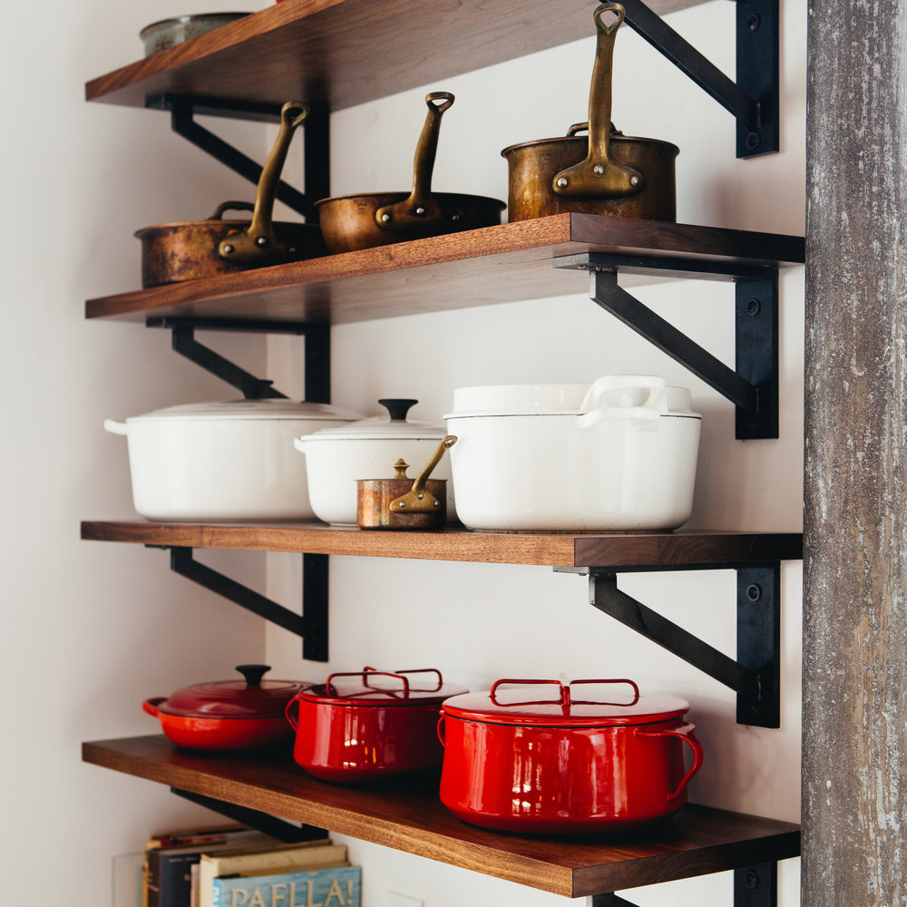Custom walnut shelves with custom brackets