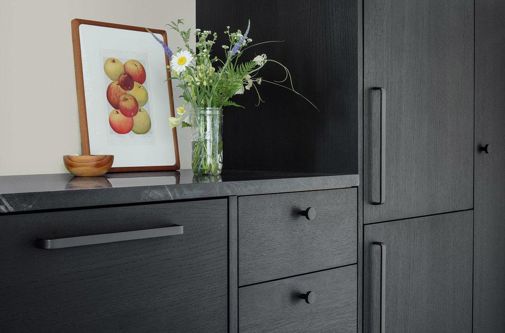custom kitchen cabinetry in ebonized oak and blackened hardware