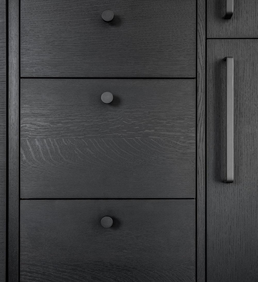 detail of custom kitchen cabinetry in ebonized oak