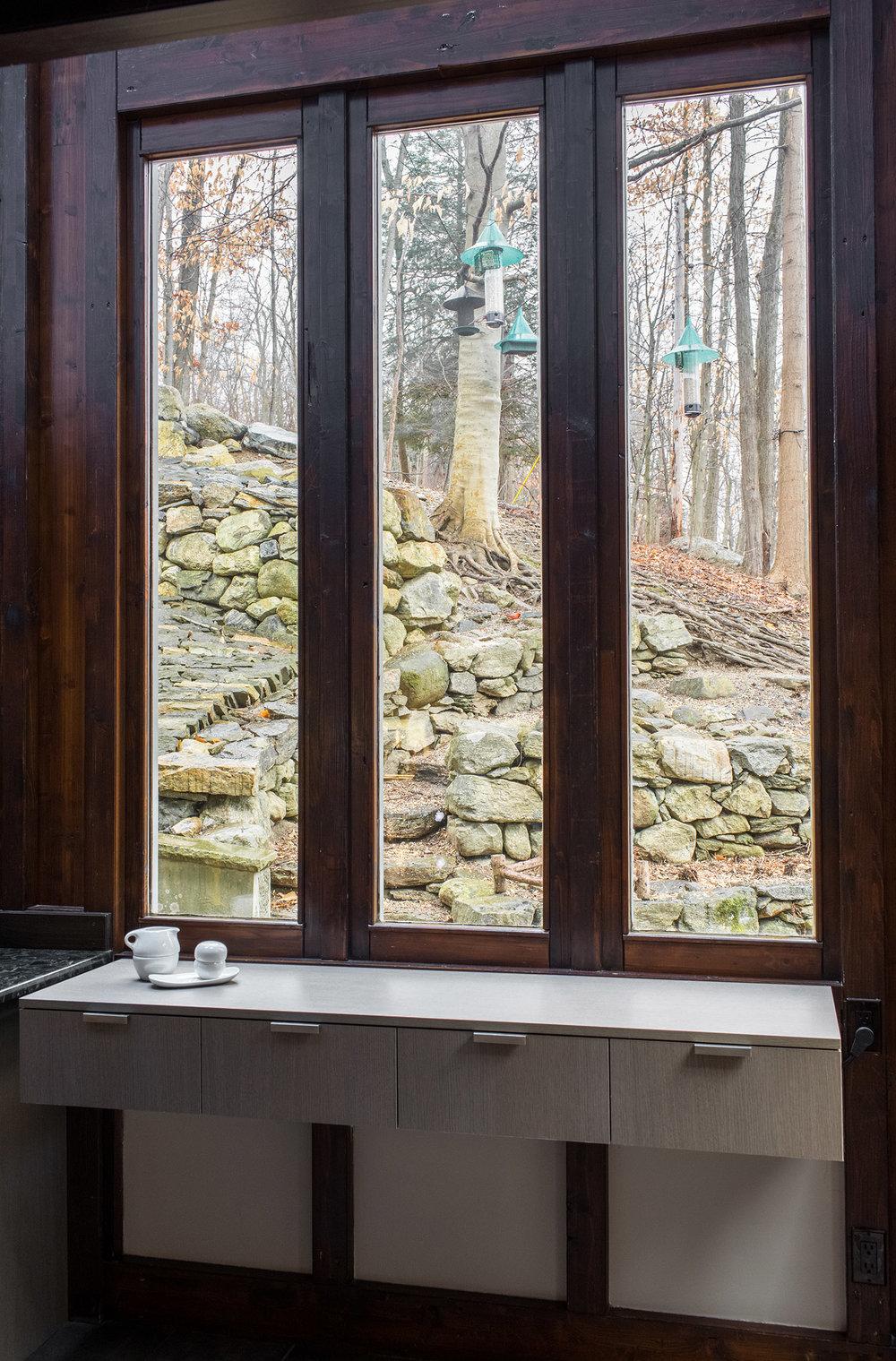 Custom floating cabinetry in grey oak Shinoki